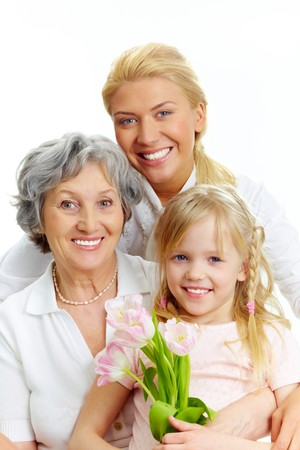 Portrait of happy female relatives looking at camera  photo