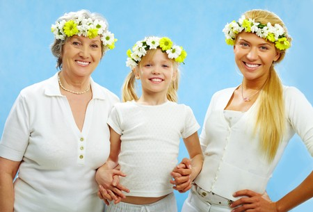 Portrait of grandmother, mother and child looking at camera with smiles photo