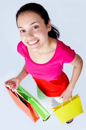 happy female with colorful shopping bags photo