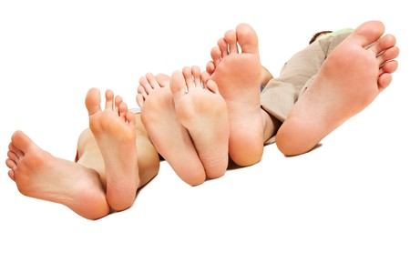 female soles: Close-up of human soles relaxing on white background