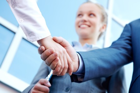 successful associates handshaking after striking deal outdoors at meeting Stock Photo - 7261411
