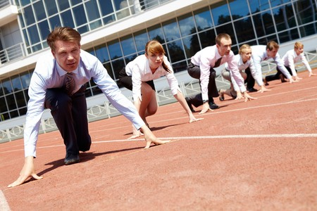 contestant: Confident business people lined up getting ready for race