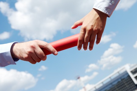 business people hands passing baton during marathon Stock Photo