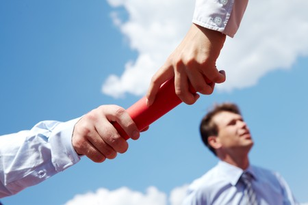 business people hands passing baton during race