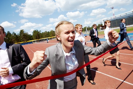business competition: Photo of happy businesswoman crossing finish line during race