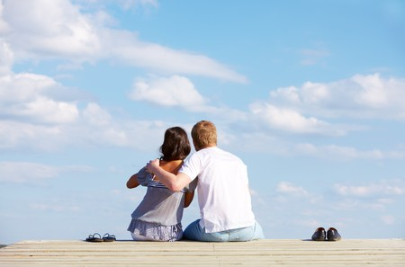 Image of guy embracing his girlfriend while enjoying hot summer day photo