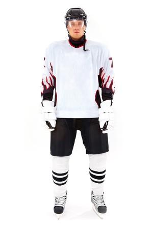hockey player: Portrait of healthy sportsman in hockey uniform in studio