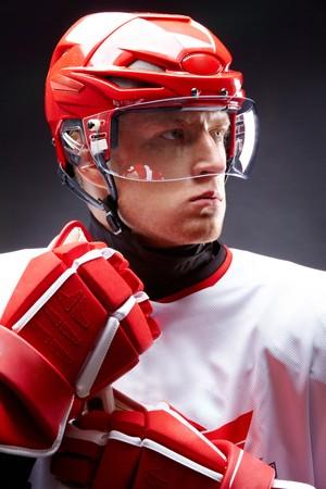 recreational sports: Portrait of sportsman in hockey uniform over black background Stock Photo