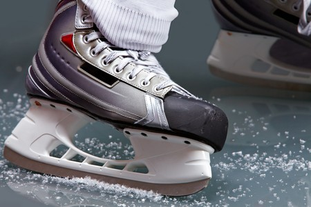 Close-up of skates on player feet during ice hockey Stock Photo - 7271819