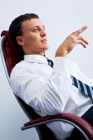 Portrait of smart businessman on workplace photo