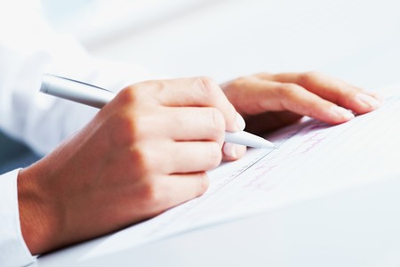 ballpoint: Close-up of business person hand with pen over document