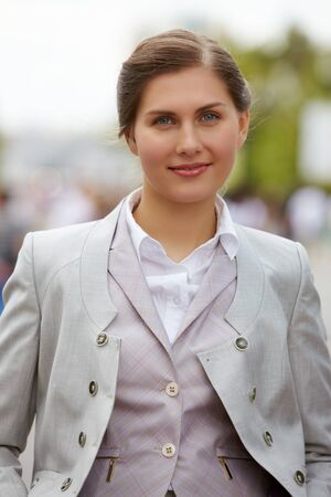 Portrait of pretty female smiling at camera outside Stock Photo - 7355657