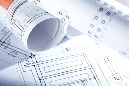 Close-up of blueprints with sketches of projects photo