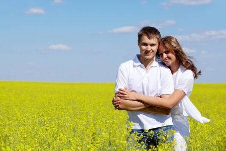 amorous woman: Image of joyful girl embracing her boyfriend in yellow meadow