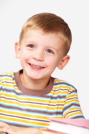 Portrait of smiling schoolboy in wearing striped t-shirt  photo