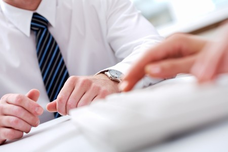 Close-up of male hands with typing secretary hands in front of him Stock Photo - 7409092