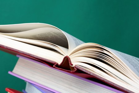 Colorful stack of textbooks with open book on its top Stock Photo - 7409129
