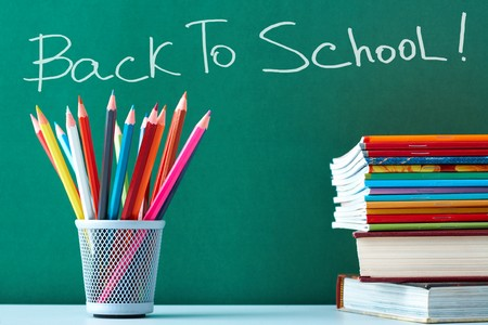 Stack of colorful textbooks and copybooks with pencils near by on background of blackboard Stock Photo - 7409174