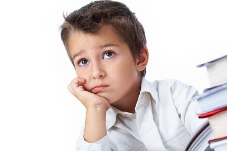 concentrated: Photo of pensive youngster concentrated on something