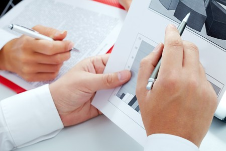 Close-up of businessman hand pointing at diagram during discussion Stock Photo - 7409216