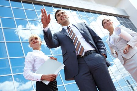 Below angle of successful partners with smart leader in front Stock Photo - 7409307