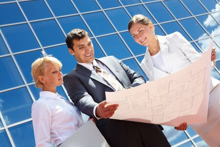 Below angle of successful partners planning work outside Stock Photo - 7409322