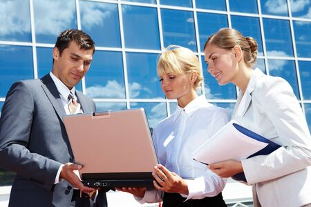 Photo of successful business partners planning work outside Stock Photo - 7409321