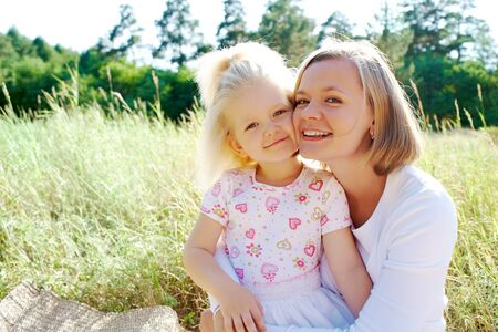 Portrait of mother embracing her daughter during summer vacation Stock Photo - 7409398