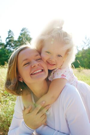 Portrait of little girl embracing her mother during summer vacation Stock Photo - 7409368