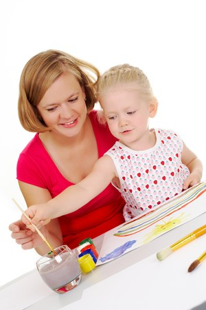 Photo of cute preschooler and her mother painting something with aquarelle Stock Photo - 7409394