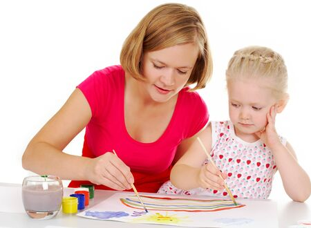 Photo of cute preschooler and her mother painting with aquarelle Stock Photo - 7409375