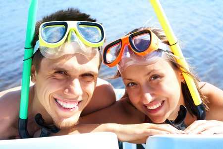 Portrait of cheerful couple in aqualungs looking at camera with smiles Stock Photo - 7437071