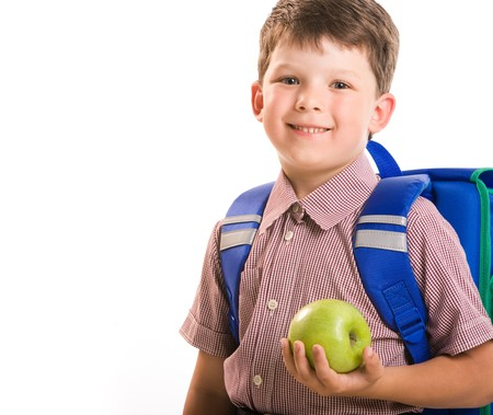 Portrait of handsome boy with a green apple isolated on a white background  photo