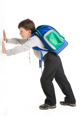 Image of schoolchild with backpack pushing wall  photo