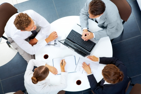 meeting place: Above view of several business people planning work at round table Stock Photo