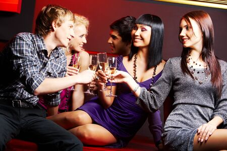 Portrait of joyful friends toasting with flutes of champagne at party Stock Photo - 7484377