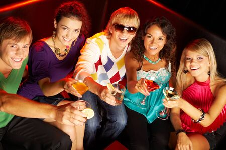 Portrait of smart young people toasting in the nightclub Stock Photo - 7484368