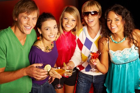 Portrait of smart young people looking at camera while toasting photo