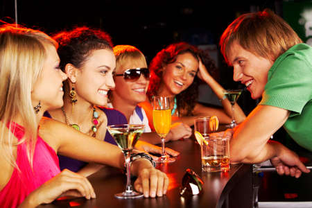 Image of happy teenagers chatting in the bar photo