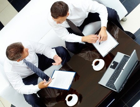 Image of two business partners discussing work at meeting photo