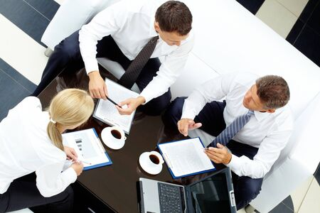 men ideas: Photo of successful partners discussing business plan at meeting Stock Photo