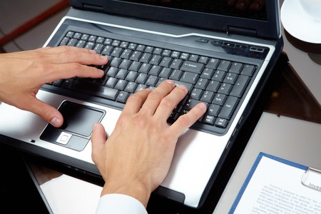 Male hands typing on the laptop Stock Photo - 7509062