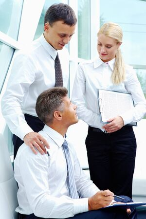 Photo of successful employees discussing business plan at meeting photo