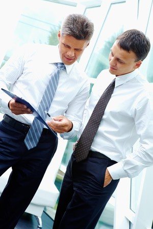 new strategy: Two smart businessmen discussing new strategy at meeting Stock Photo