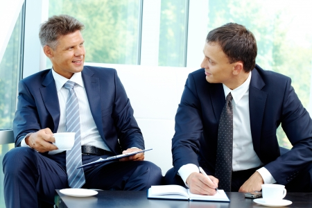 new strategy: Image of smart businessmen discussing new strategy at meeting