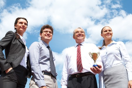 Portrait of confident business group on background of cloudy sky photo