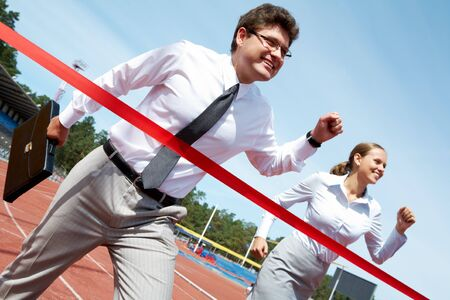 Photo of successful businessman crossing finish line during race Stock Photo - 7508993