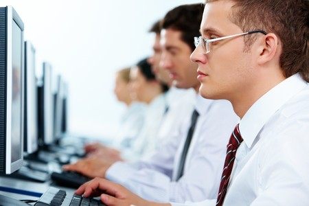 Smart businessmen typing in line at workplaces   Stock Photo - 7509072