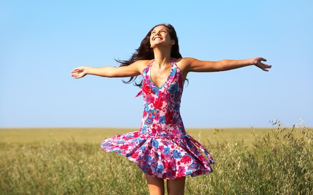 excited people: girl enjoying life in wheat meadow Stock Photo