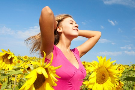 pretty girl among sunflowers having nice time on sunny day Stock Photo - 7518029